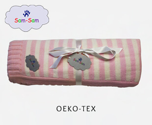 Barnfilt Rosa liggande grå bakgrund logo